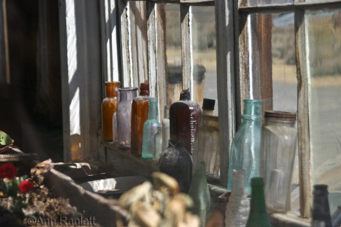 Another View of the Bottles in a Window
